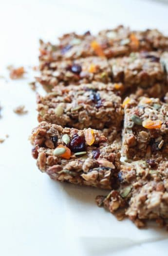 A close-up shot of homemade granola bars arranged on a white countertop