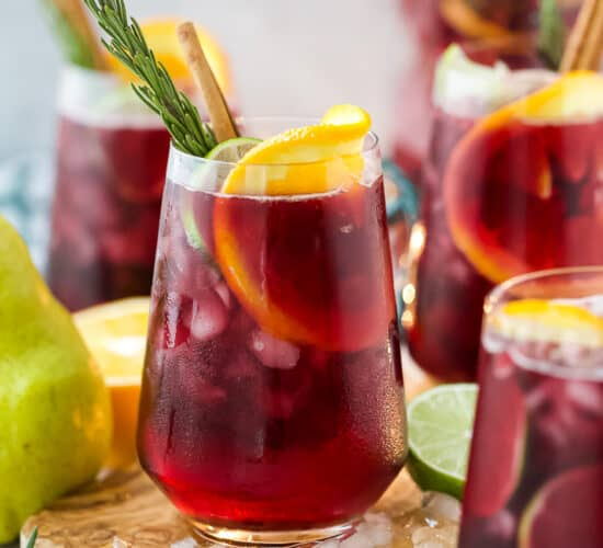 the ultimate holiday sangria recipe in a glass with ice