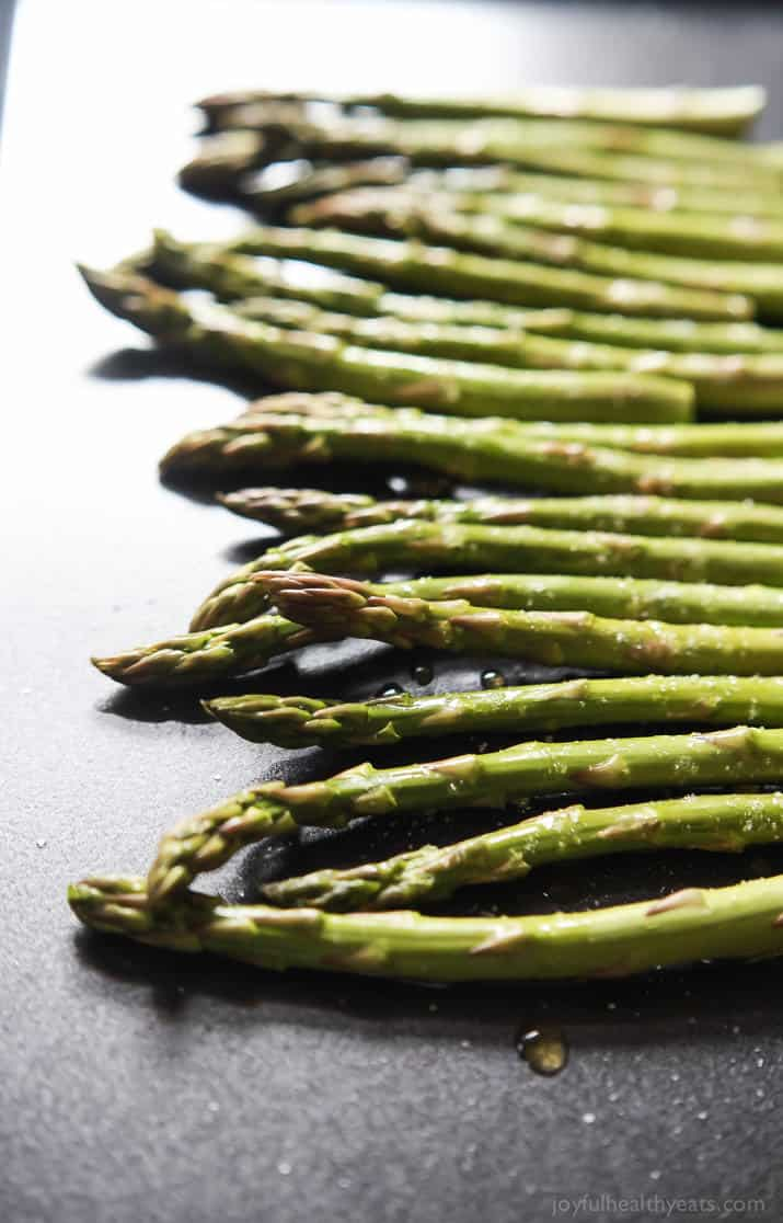 Asparagus spears on a baking sheet