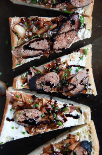 This Balsamic Italian Sausage Crostini topped with Whipped Goat Cheese is the perfect party appetizer to wow your guests for the holidays. It's fancy, delicious, and so easy! | joyfulhealthyeats.com