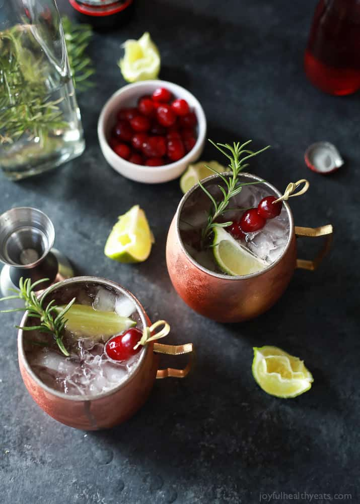 Top view of two mugs of Cranberry Moscow Mule with Rosemary Infused Vodka