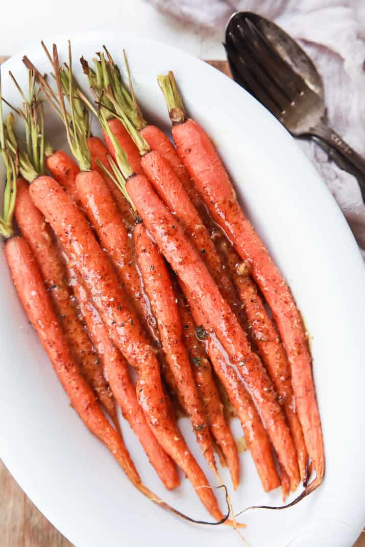 3 Ingredient Honey Mustard Glazed Carrots piled in a white bowl
