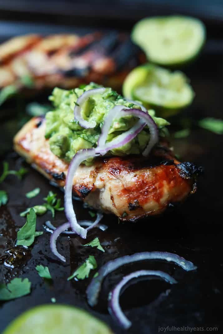 Grilled Cilantro Lime Chicken with Avocado Salsa - a healthy, easy, 30 minute meal packed with fresh zesty flavors. This chicken recipe will quickly be a favorite! | joyfulhealthyeats.com #paleo
