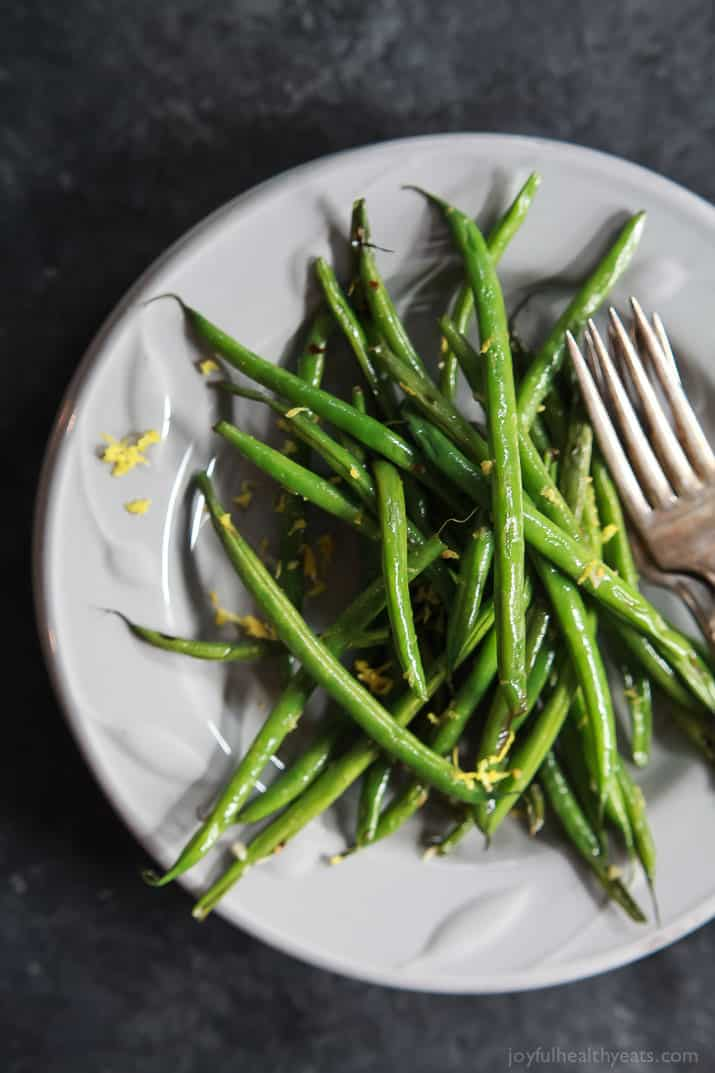 A Pile of Skillet Green Beans with Lemon and Garlic on a White Plate