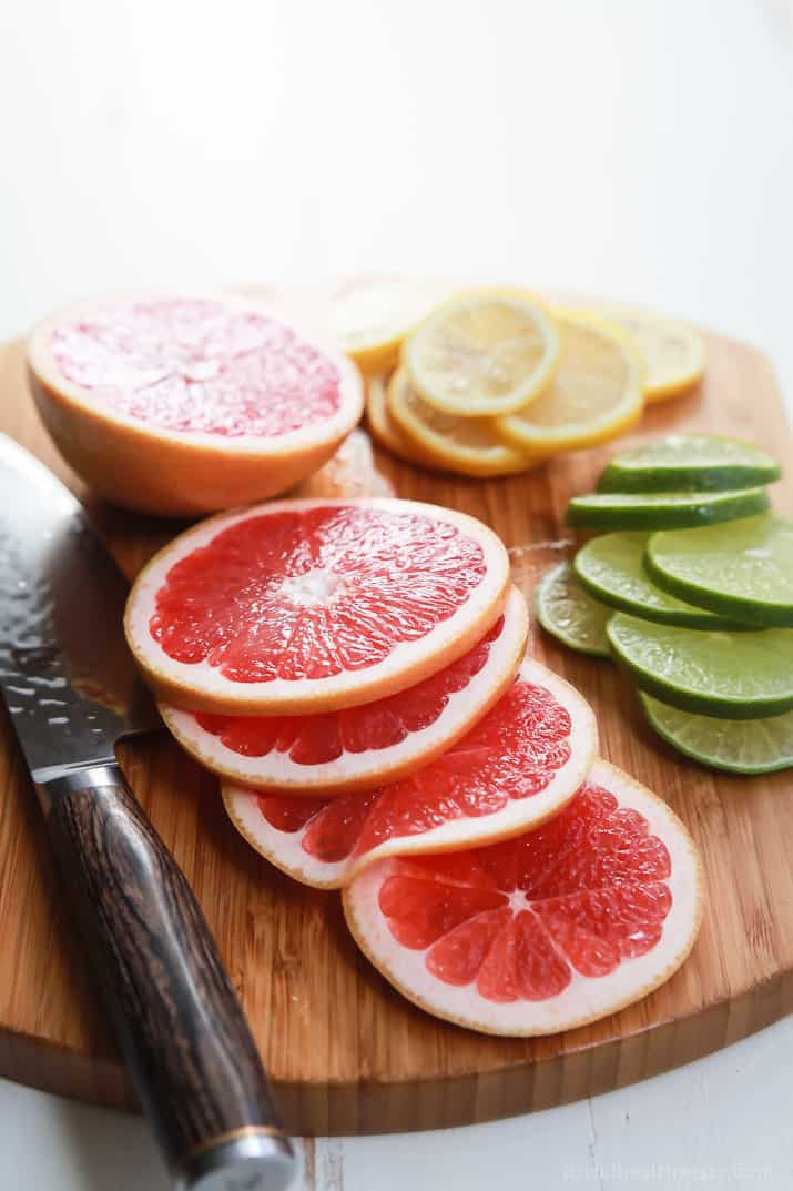 Sliced citrus fruit on a cutting board