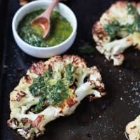 Easy naturally Gluten Free Roasted Cauliflower Steaks topped with fresh zesty Chimichurri Sauce at only 106 calories. Who knew Cauliflower could taste so good! This recipe is down right addicting! | joyfulhealthyeats.com Easy Healthy Recipes