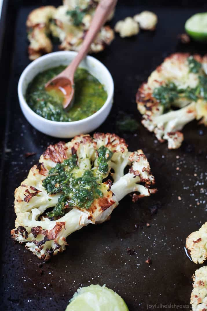 Easy naturally Gluten Free Roasted Cauliflower Steaks topped with fresh zesty Chimichurri Sauce at only 106 calories. Who knew Cauliflower could taste so good! This recipe is down right addicting!   joyfulhealthyeats.com Easy Healthy Recipes
