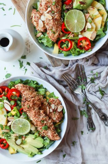 Change up your salad game with this Tropical Coconut Chicken Salad filled with fresh exotic fruits and homemade almond-coconut crusted chicken tenders. It's a swoon worthy salad that'll take you to the beach and you'll want to repeat all week! | joyfulhealthyeats.com Easy Dinner Recipes