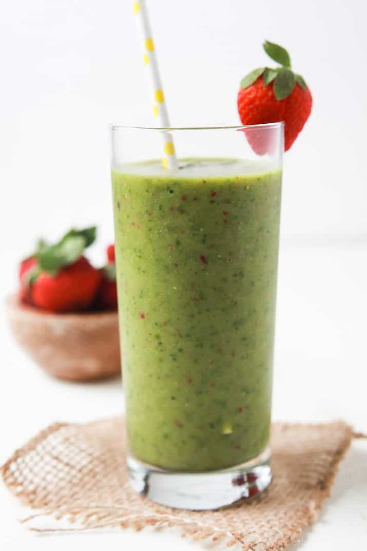An Easy Tropical Green Smoothie that actually tastes GOOD, only has 5 ingredients, is dairy free, nutritious, and an energy booster! The perfect way to start off the New Year! | joyfulhealthyeats.com