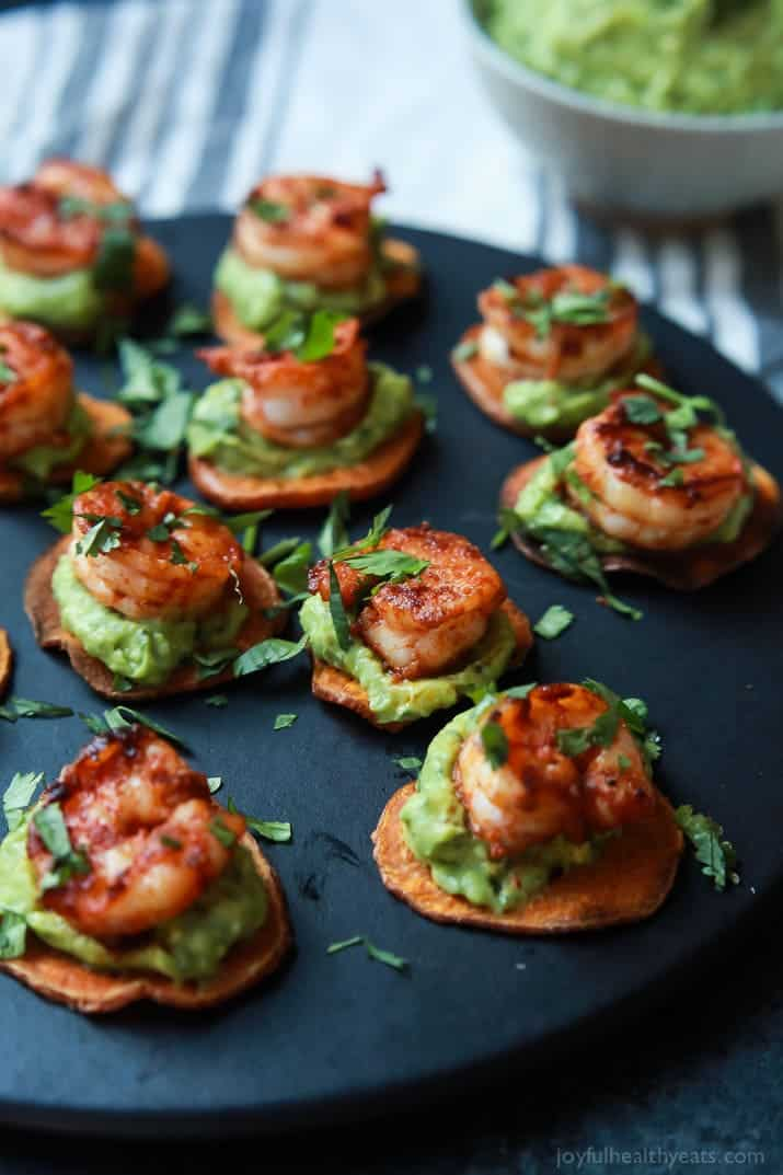 Cajun Shrimp Guacamole Bites on sweet potato slices