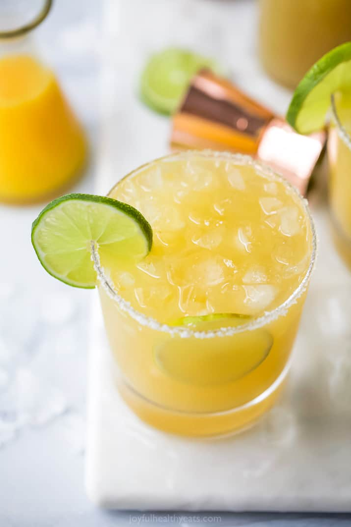 a glass filled with a classic margarita