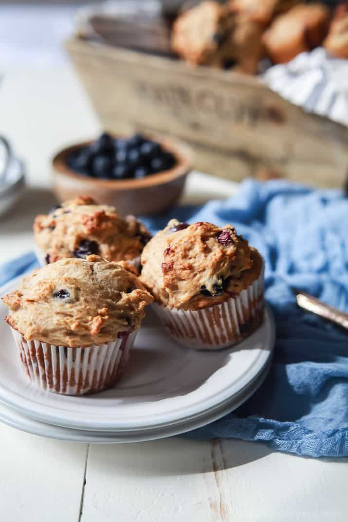 These extremely Moist Lemon Blueberry Muffins are so easy to make, filled with fresh lemon and blueberry flavor, and made with no butter or refined sugar! The BEST muffin ever! | joyfulhealthyeats.com