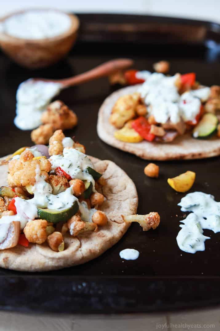 Moroccan Cauliflower Chickpea Pita - done in 35 minutes, filled with spiced roasted vegetables & covered in Tzatziki Sauce. A meal your family will love and perfect for meatless Monday! | joyfulhealthyeats.com #vegetarian