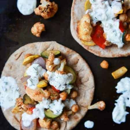 Moroccan Cauliflower Chickpea Pita - done in 35 minutes, filled with spiced roasted vegetables & covered in Tzatziki Sauce. A meal your family will love and perfect for meatless Monday!   joyfulhealthyeats.com #vegetarian
