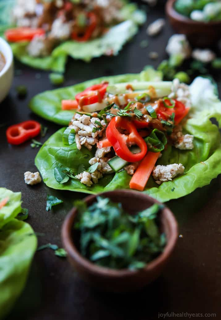 Thai Chicken Lettuce Wraps - made from scratch with chicken, fresh ginger, cilantro, fresh vegetables and slathered with a Spicy Peanut Sauce. This quick easy recipe is ready in just 20 minutes and to die for! | joyfulhealthyeats.com #glutenfree