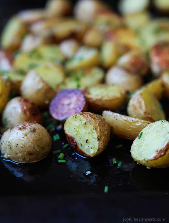 Close-up of Garlic Ranch Potatoes on a baking sheet