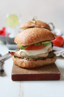 grilled avocado caprese chicken sandwich with a toothpick in it