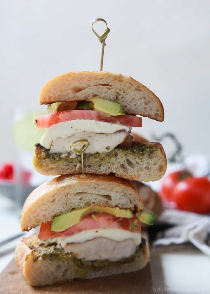 Easy, delicious, and perfect for the warm weather! Grilled Avocado Caprese Chicken Sandwich, a gorgeous sandwich with crunchy bread, moist chicken, and fresh basil pesto! YUMM-O! | joyfulhealthyeats.com