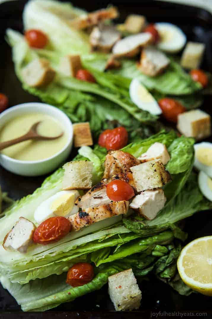 Grilled Chicken Caesar Salad with a Light Caesar Dressing that is egg and anchovy free! This Salad takes 15 minutes to make, is 289 calories a serving, and you can't beat that dynamite grill flavor infused throughout this dish! | joyfulhealthyeats.com Easy Dinner Ideas