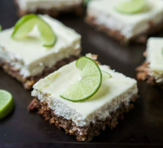 A few Easy Key Lime Cheesecake Bars made lighter with Greek yogurt and a delicious cinnamon pecan crust. This simple dessert is pure cheesecake perfection and guaranteed to win over the hearts of many! | joyfulhealthyeats.com