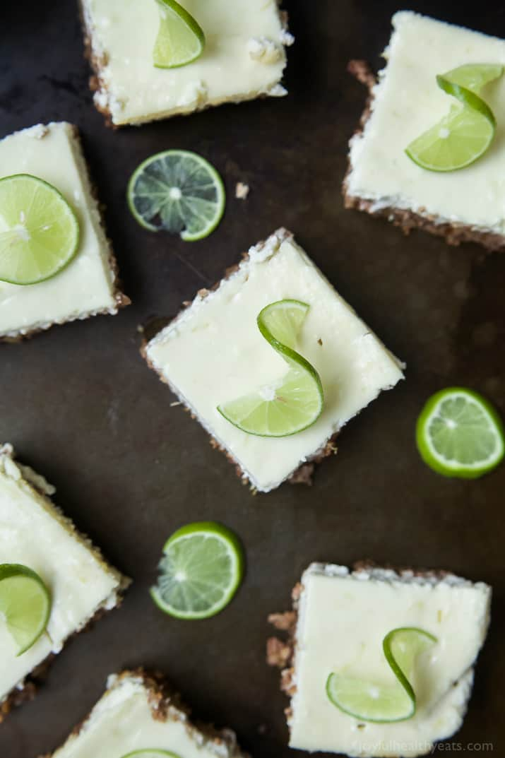 Easy Key Lime Cheesecake Bars made lighter with Greek yogurt and a delicious cinnamon pecan crust. This simple dessert is pure cheesecake perfection and guaranteed to win over the hearts of many! | joyfulhealthyeats.com