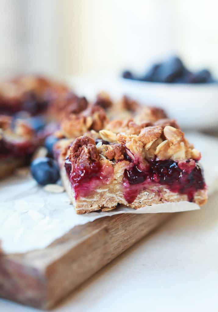 Lemon Blueberry Oatmeal Bars, filled with fresh fruit, lemon zest, and topped with a crumble that you won't be able to stop munching on! These Bars are easy to throw together and make a great breakfast, snack, or even dessert!   joyfulhealthyeats.com