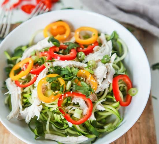 Thai Chicken Zucchini Noodle Salad with a Sesame Vinaigrette done in 15 minutes and only 324 calories. This salad is served cold with raw zucchini noodles, it is refreshing, light, filled with bold flavors and perfect for the summer! | joyfulhealthyeats.com #glutenfree