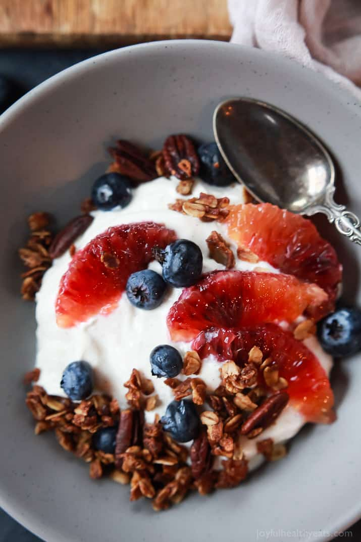 A healthy and Light Yogurt Breakfast Bowl filled with pops of flavor from sweet blood orange and tart blueberries then finished with homemade Vanilla Granola! You'll never want another breakfast again! | joyfulhealthyeats.com