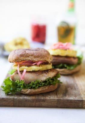 Blackened Mahi Mahi Fish Burger with a bun on a wooden board