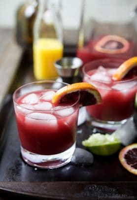 A simple Blood Orange Margarita that's friendly on the waist using no simple syrup. This Margarita Recipe is the perfect party drink - it's fresh, citrus-y, packs a flavor punch and makes enough for a crowd! | joyfulhealthyeats.com