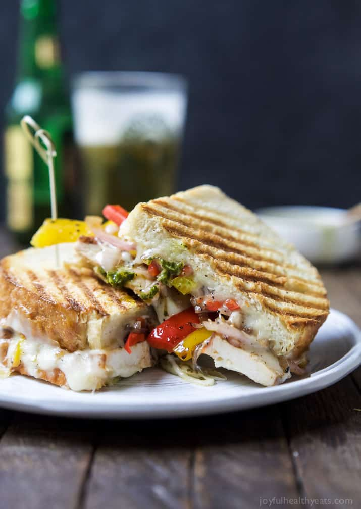A Grilled Chicken Fajita Panini filled with juicy spice rubbed chicken, grilled peppers and onions, creamy fontina cheese, and zesty chimichurri for the perfect sandwich bite. You'll want this sandwich for lunch AND dinner! | joyfulhealthyeats.com