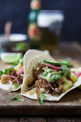 Pork Carnitas Tacos on a wooden board