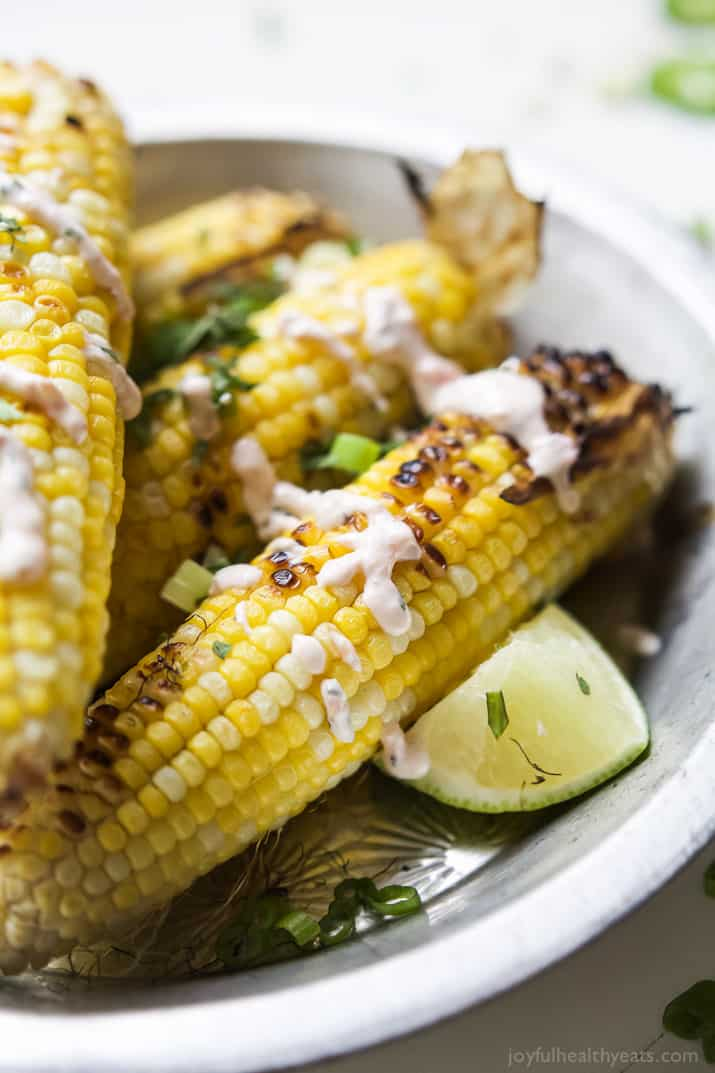 Mexican Corn just got blown out of the water! This Easy Grilled Corn on the Cob is topped with a Creamy Roasted Jalapano Sauce you'll swoon over! This grilled corn is the new star of the summer! | joyfulhealthyeats.com #glutenfree