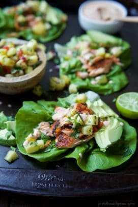 The perfect healthy twist on the original fish tacos! These Southwestern Grilled Salmon Tacos are bursting with flavor and topped with fresh pineapple salsa and a Chipotle Lime Crema! Addicting! | joyfulhealthyeats.com