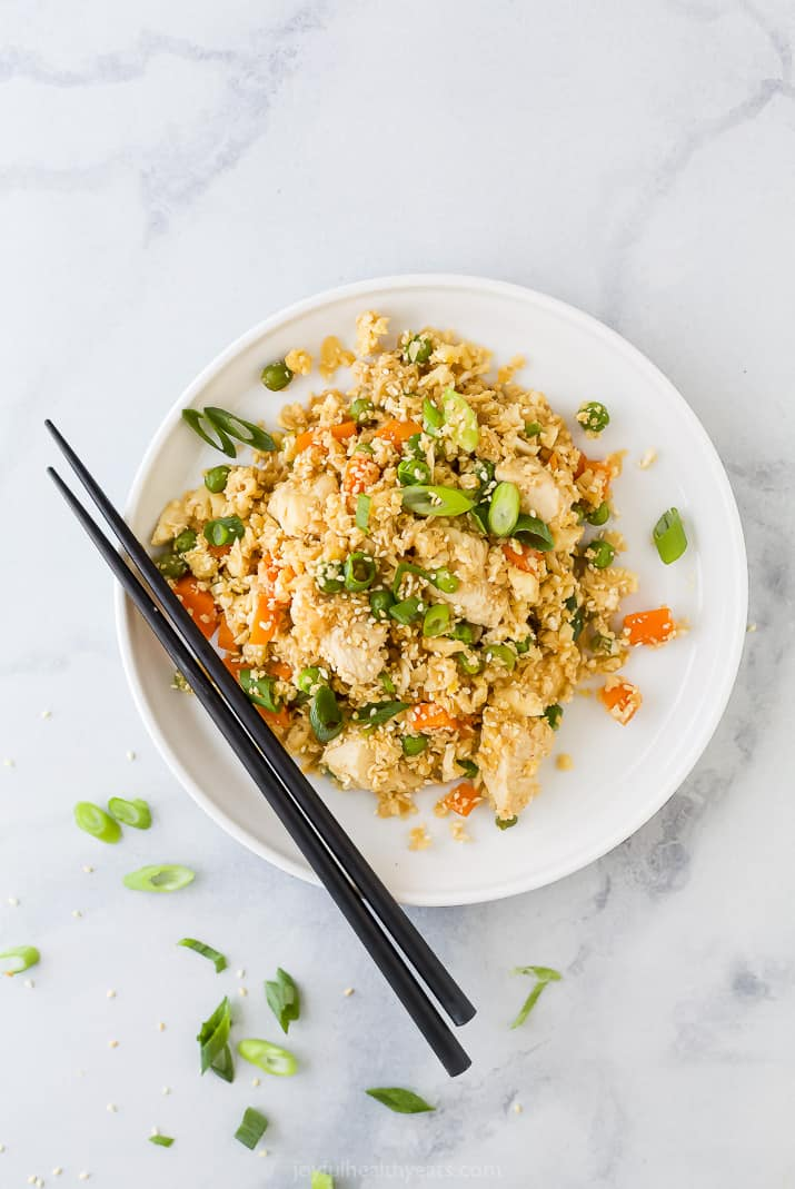 low carb chicken fried rice on a plate with chopsticks