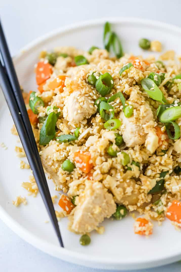 cauliflower fried rice with chicken on a plate