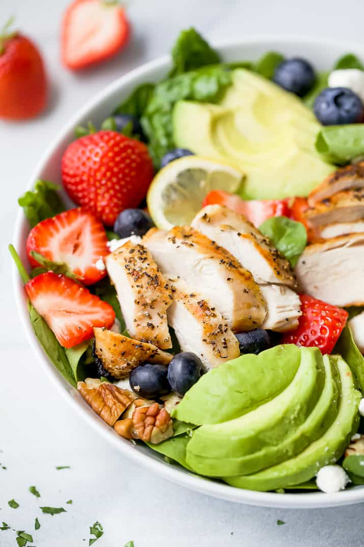 side photo of best avocado strawberry salad with grilled chicken