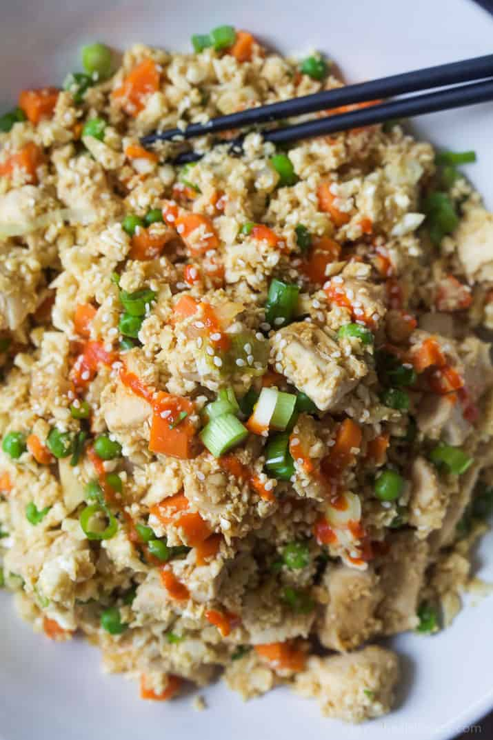 Close-up of Chicken Cauliflower fried rice with vegetables in a bowl