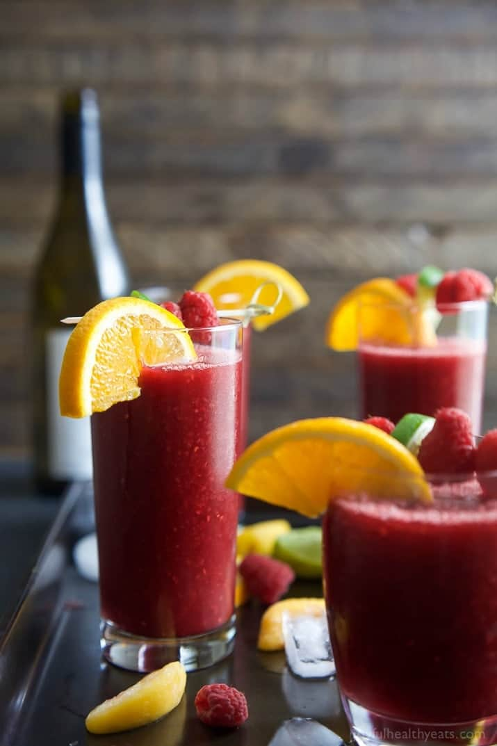 Frozen Raspberry Peach Sangria in glasses garnished with fruit