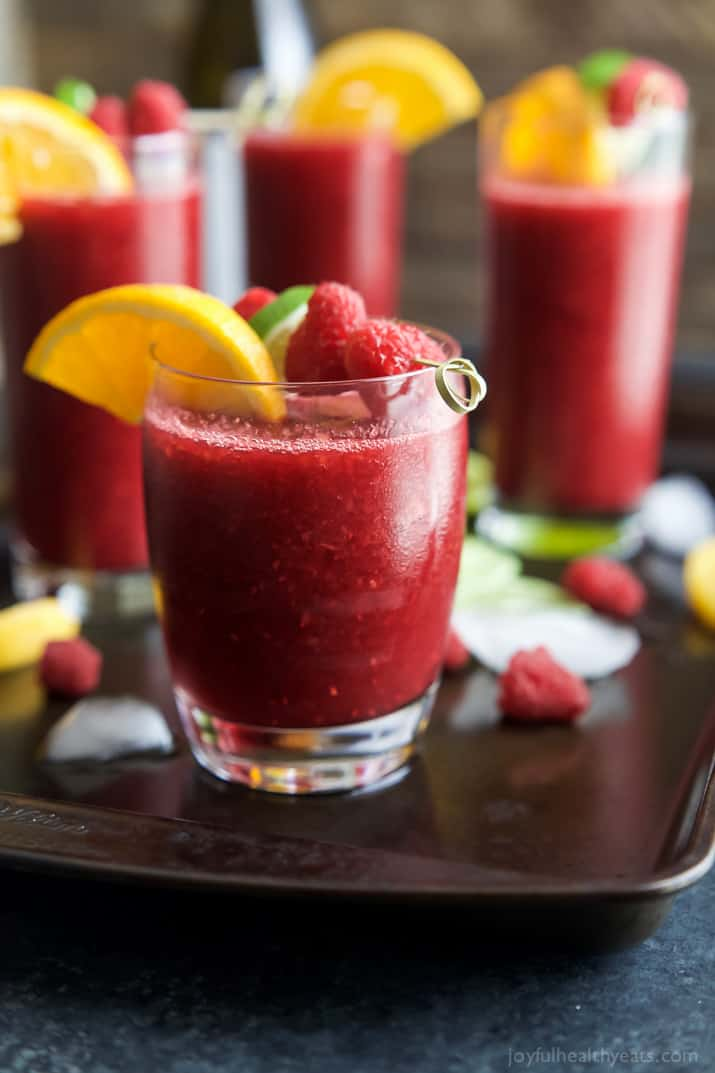 Frozen Raspberry Peach Sangria in glasses garnished with fresh fruit