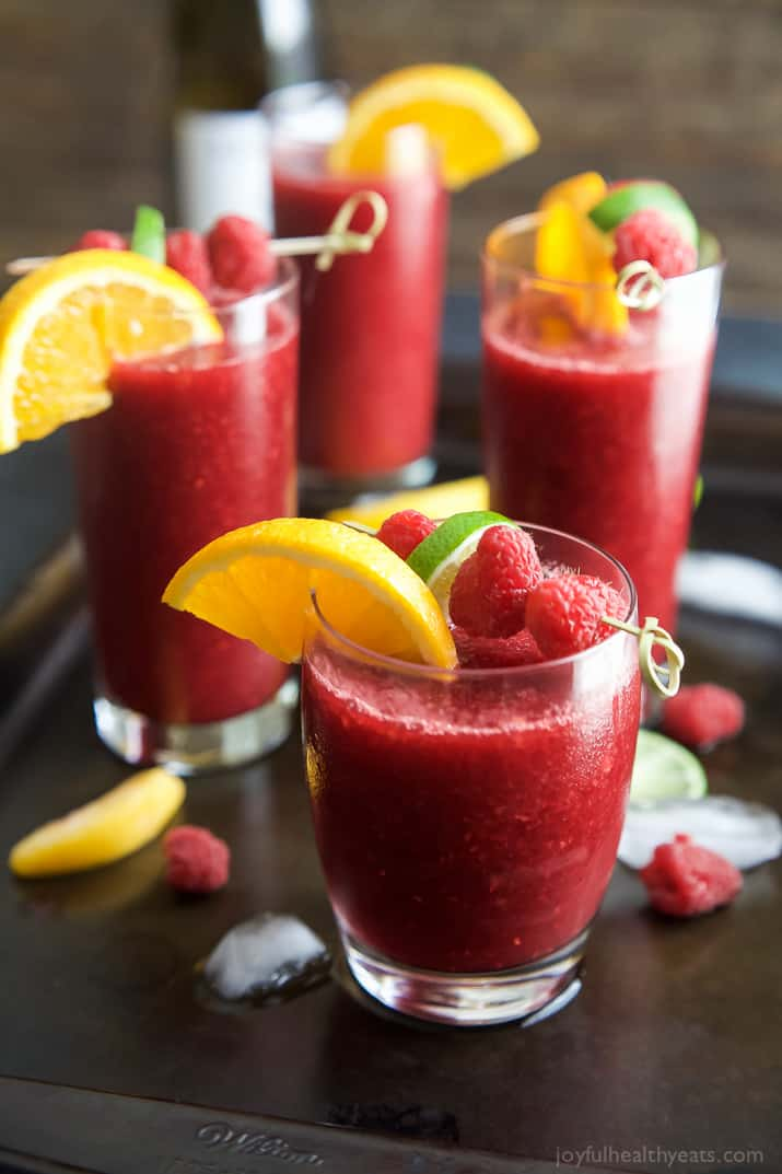 Glasses of Frozen Raspberry Peach Sangria garnished with fruit
