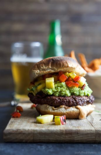Smoky Avocado Burgers topped with a Pineapple Pepper Relish! These burgers don't run short on flavor, they are juicy, tender, mouthwatering basically everything you want in a Burger + more! | joyfulhealthyeats.com