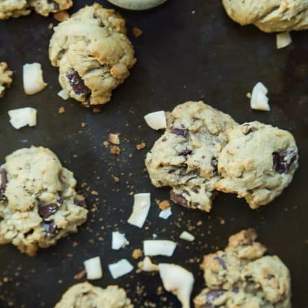 Toasted Coconut Chocolate Chunk Cookies that are soft, chewy, oozing with chocolate goodness all while using LESS butter and sugar! I guarantee you'll want to hoard these cookies!   joyfulhealthyeats.com