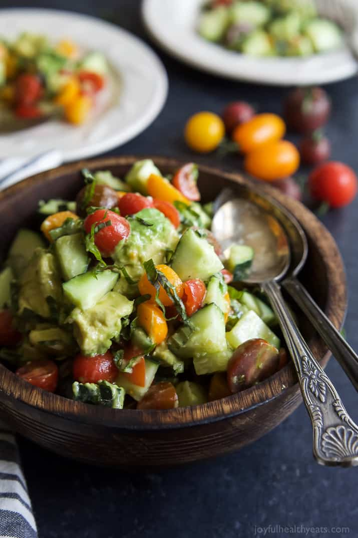 This summer Tomato Avocado Cucumber Salad is pure perfection - light, refreshing, 5 minutes to make, minimal ingredients, low on calories and booming with flavor! | joyfulhealthyeats.com #paleo #glutenfree
