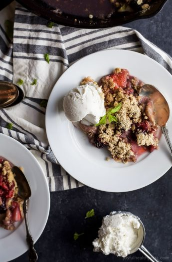 Nothing screams summer like fresh berries! This Very Banana Berry Crumble is loaded with bananas, 3 different kinds of berries and topped with a buttery crunchy crumble for the ULTIMATE dessert! | joyfulhealthyeats.com