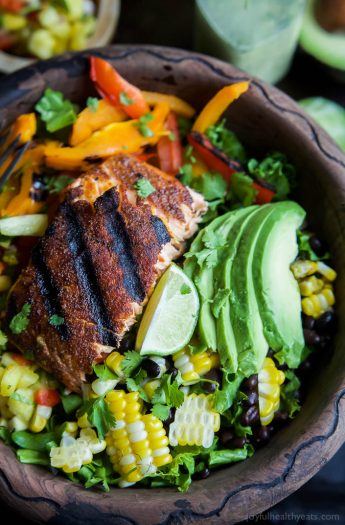 Blackened Grilled Salmon Salad topped with grilled corn, black beans, fresh Pineapple Salsa and a Citrus Cilantro Vinaigrette you'll swoon over! This Salad is what dreams are made of and all packed into a small bowl! | joyfulhealthyeats.com #paleo #glutenfree