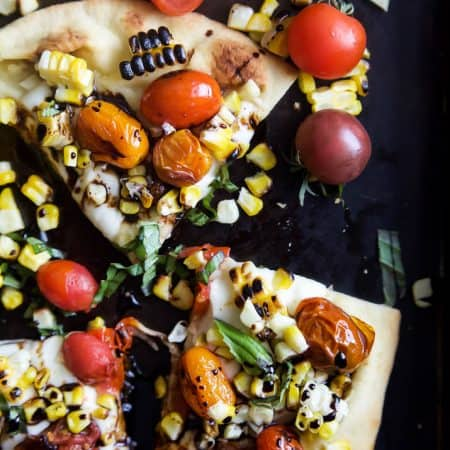 An easy delicious Charred Corn Caprese Flatbread topped with sweet Balsamic Reduction - it screams summer, takes 30 minutes to make, and uses less than 10 ingredients! You're gonna love it! | joyfulhealthyeats.com