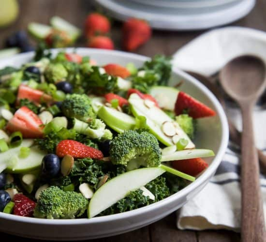 """A super healthy Detox Summer Salad filled with kale, broccoli, fresh berries, and almonds then topped with a """"lick your plate"""" worthy Citrus Basil Vinaigrette! This salad is great for lunch or the perfect side to bring to your next BBQ!   joyfulhealthyeats.com #glutenfree #paleo"""