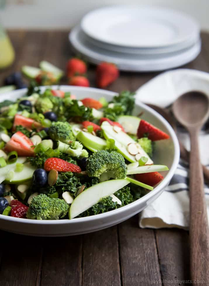 "A super healthy Detox Summer Salad filled with kale, broccoli, fresh berries, and almonds then topped with a ""lick your plate"" worthy Citrus Basil Vinaigrette! This salad is great for lunch or the perfect side to bring to your next BBQ! 