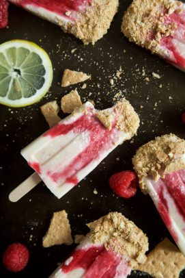 Lemon Raspberry Cheesecake Popsicles, creamy, lemony and filled with fresh fruit. The perfect refreshing treat to cool you down this summer, they taste just like biting into a real cheesecake except half the calories! | joyfulhealthyeats.com